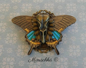 Brooch butterfly skull bird
