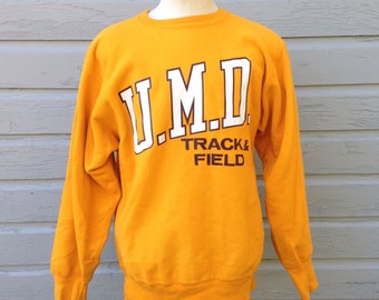 Late 80's, early 90's Champion reverse weave UMD Track & Field sweatshirt, fits like a large