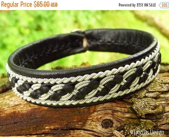 Sami Viking Bracelet Norse FAFNIR Handmade Women and Mens Black Leather Cuff with Pewter Braid and Antler Closure from Tjekijas Design