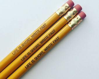 life is short, write fast engraved pencils in mustard yellow. writing inspiration for your hand.