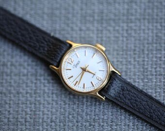 vintage Timex quartz watch very small with black leather band