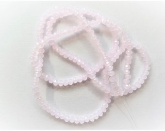 Light Pink Faceted 2mm* 3mm AB seed beads. Approximately 200CT (1 strand) K67A