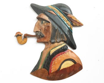vintage hand carved souvenir plaque, pipe smoking man, Swiss or German collectible, feather hat, wood folk art