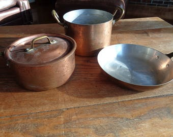 Vintage Solid Copper Cookware Set in Vintage Condition consisting of a stock pot, a sauce pan and fry pan and a lid that fits on two pots