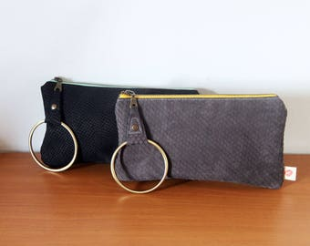 Printed leather wristlet with brass bangle zipper pull. Scallopped gray with yellow zip or snakeskin black and mint, not lined Ready to ship