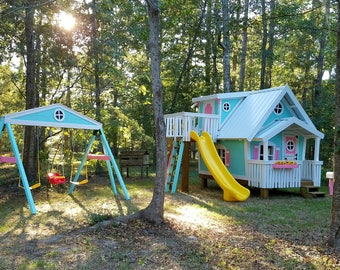 The Big Playhouse XL with stilts and swingbeam by Imagine That Playhouses!