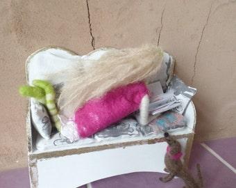 Girl with dachshund reading on the sofa, figurine group, felt art, 24 cm,