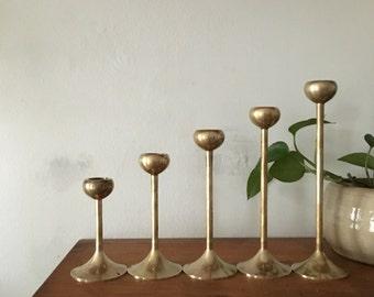 set of 5 vintage brass graduated tulip candlestick holders. mid century glam candleholders. interior design modernist decor