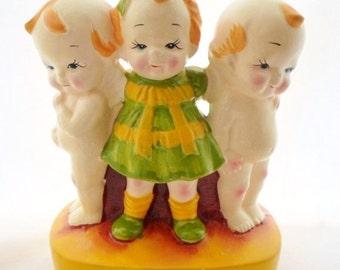 ON SALE Vintage Kewpie Ceramic Bank, Shepherd Of The Hills Farm, 2 Kewpies, Girl, Mustard, Green, Yellow, Home Decor, Childs Room, Collectib