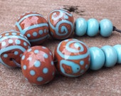 Lampwork Beads in Cinnamon with Turquoise Line Design and 6 Spacer Beads