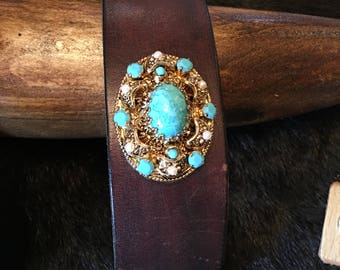Vintage circa 1950's turquoise cabochon, faux pearl, and gold filigree brooch with brown leather cuff belt
