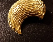 Pretty decorative gold tone BSK brooch