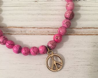 Hot pink magnesite beaded bracelet with small gold plated peace sign; stretch bracelet; pink bracelet