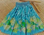 Bright lehua print pa'u. women's aqau hula pa'u