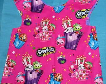 Shopkins toddlers smock, apron or bib size 2-5 years lined with big button closure in the back