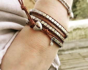 A handmade vintage leather wrap bracelet with tibetan silver square beads and a tiny sterling silver heart charm