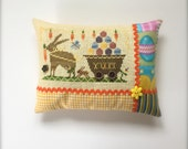 Completed primitive cross stitch Delivering Yummy Goodness pincushion, Easter Primitive, Easter pincushion, Easter gift