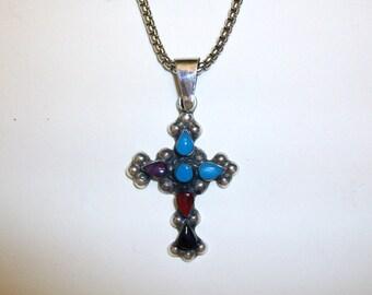 Sterling silver Zuni Native American handmade cross. Semi-precious stones.