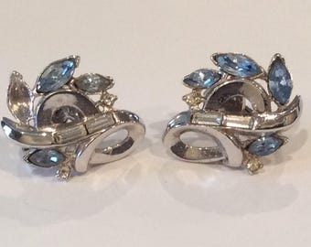 Crown Trifari signed Aqua Blue Marquee and Clear Channel set Crystal Rhinestones set in Silvertone metal Clip back Earrings