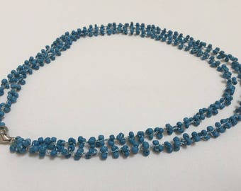 Crochet neckless with beads.