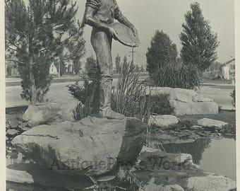 Gold miner statue antique photo California