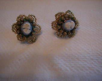 Pastel Blue cameo earrigs with screwbacks from mid century.  Pearl accents and scalloped beading on the outer edge.