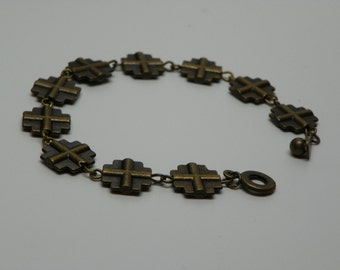 Metal bronze color Decade bracelet made up of square cross pendents with snap clasp (RB2)