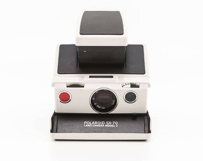 Featured listing image: Polaroid SX-70 Land Camera Model 2 Ivory Plastic Body with NEW Black Leather Covering - Film Tested and Guaranteed Working