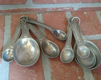 VINTAGE MEASURING SPOONS,lot of 2 used