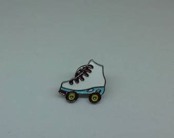 A fun roller skate boot enamel brooch pin