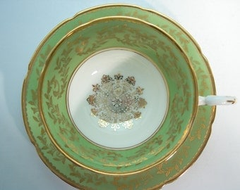 Royal Grafton  Green and gold Tea Cup And Saucer, Gold Medallion and gold Filigree tea cup and saucer.