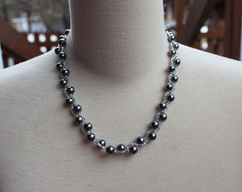 Grey collar to neck woven with glass beads