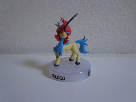 Pokemon black or white rare keldeo vinyl toy novelty cake for Anime beyblade cake topper decoration set