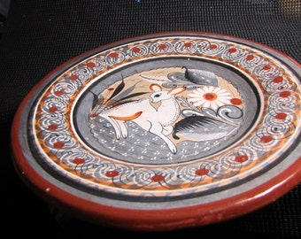 A Beautifully hand painted Mexican Folk Art Red Clay Pottery Plate.