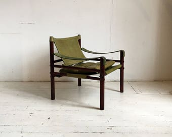 An original  vintage Arne Norell sirocco safari chair in green leather