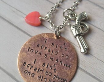 I ain't afraid to love a man..I ain't afraid to shoot a man either Annie Oakley stamped necklace with gun charm