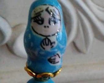 Lapel Pin or Hat Pin 3 inch gold like with a Tiny Blue Russian Nesting Doll ceramic bead