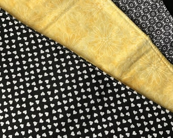 Yellow and black burp cloth set