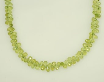 "4x5mm Faceted Peridot Teardrop Shape Briolette 54ct., 10"" long"
