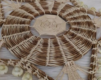 Star shaped shell and wicker wall hanging