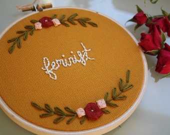 Feminist embroidery with floral border