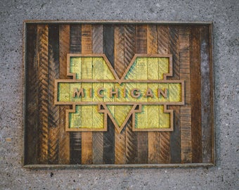 handcrafted university of michigan logo on salvaged wood