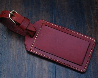 Handmade leather luggage tag with clear plastic window, tan leather, nickel plated brass hardware, luggage name tag