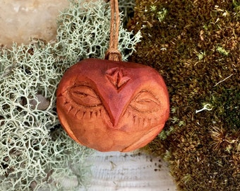 Carved avocado pit pendant. Owl.