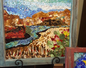 hand cut stained glass mosaic on a repuropsed window