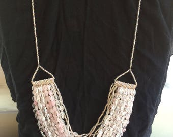 Multi strand necklace with pale pink and clear quartz stones and seed beads