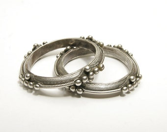 A pair of fine old Saharan bangles with granulation priced individually