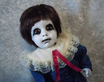Sad Little Creepy Boy Doll