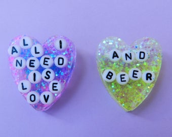 Pair of brooches alcoholic of love