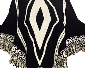 Women black beige fringe trim boho free spirited diamond design warm winter Poncho sweater.